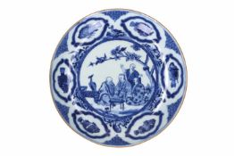 A blue and white porcelain deep dish with Cornelis Pronk decor of the Doctors' Visit. Unmarked.