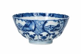A lobed blue and white porcelain bowl, decorated with with long Elizas, flowers and little boys.