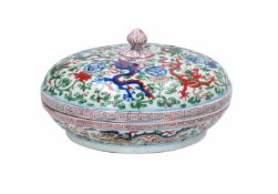 A Wucai porcelain lidded bowl, decorated with dragons and flowers. The bowl with nine