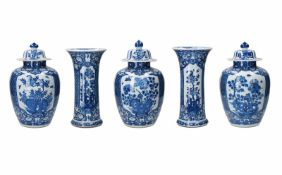 A five-piece blue and white porcelain garniture, decorated with flowers. Unmarked. China, Kangxi.