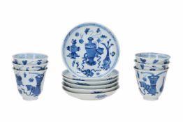 A set of six blue and white porcelain cups with saucers, decorated with antiquities and flowers.