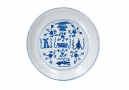 A blue and white porcelain dish, decorated with antiquities. Marked with 6-character mark