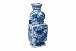 A blue and white porcelain wall vase, decorated with flowers, butterflies and censers. Marked with