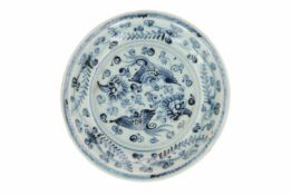 A blue and white porcelain deep dish, decorated with two phoenixes among flowering plants. Unmarked.