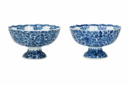 A pair of blue and white porcelain tazzas, decorated with flowers. Marked with symbol. China,