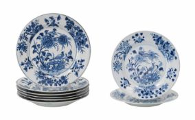 A set of eight blue and white porcelain dishes, decorated with a bird and flowers. Marked with 6-