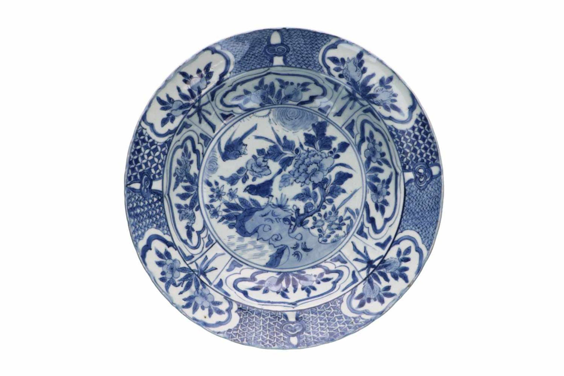 A blue and white 'kraak' porcelain deep dish, decorated with flowers, fruits and birds. Unmarked.