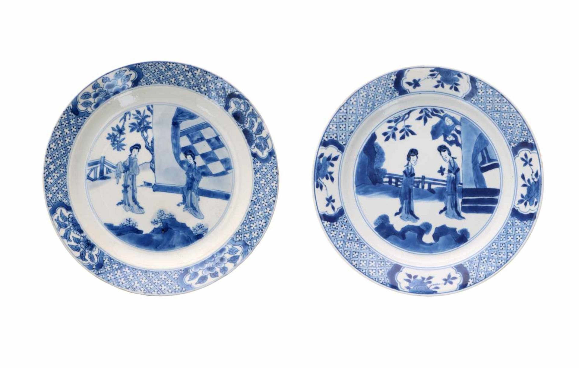 Lot of two blue and white porcelain dishes, decorated with long Elizas. Marked with 6-character
