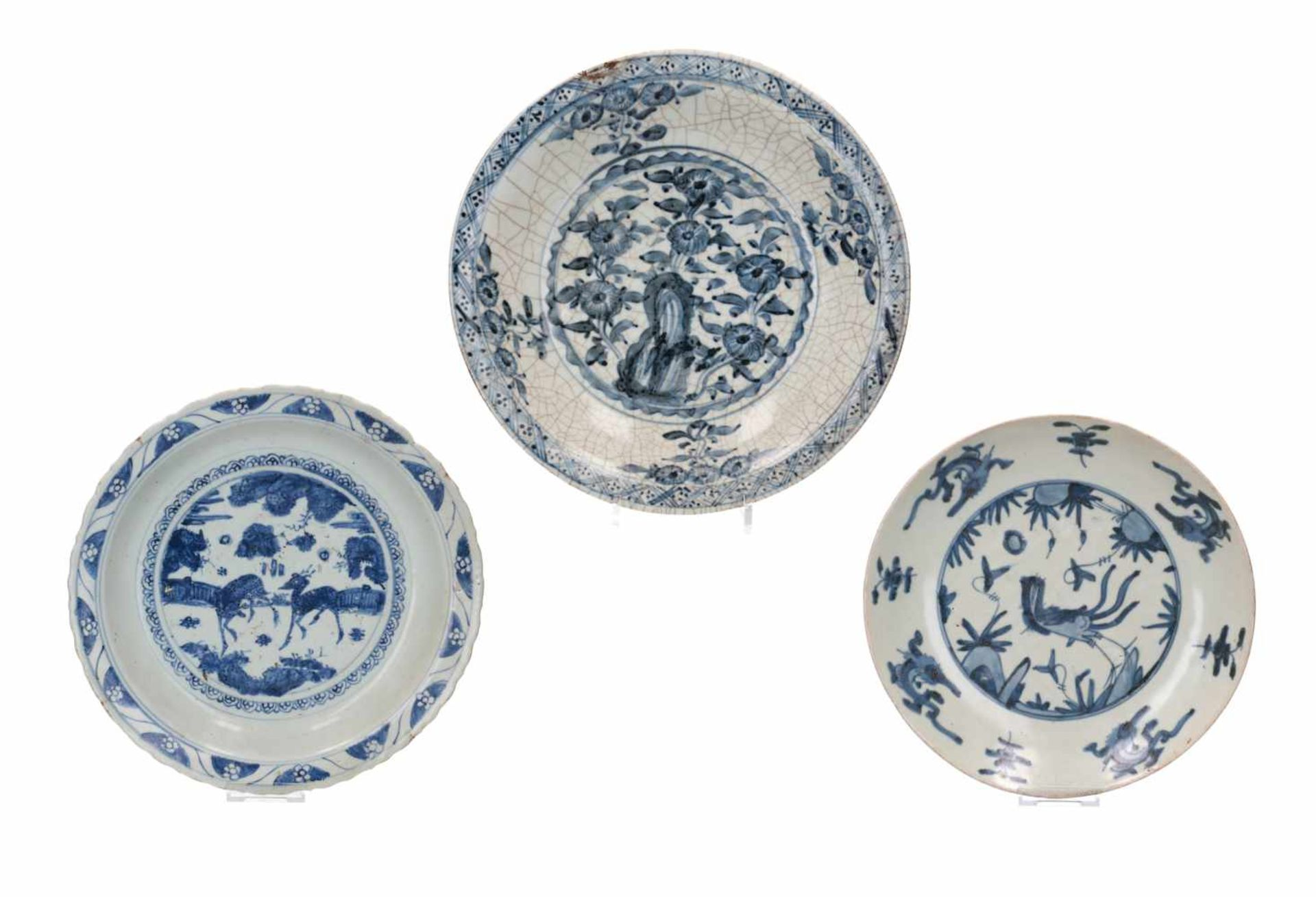 Lot of three blue and white Swatow porcelain chargers, decorated with flowers and animals. One