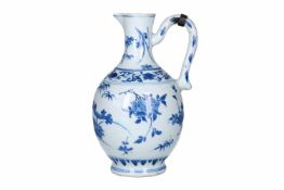 A blue and white porcelain jug with silver mounting, decorated with flowers. Unmarked. China,