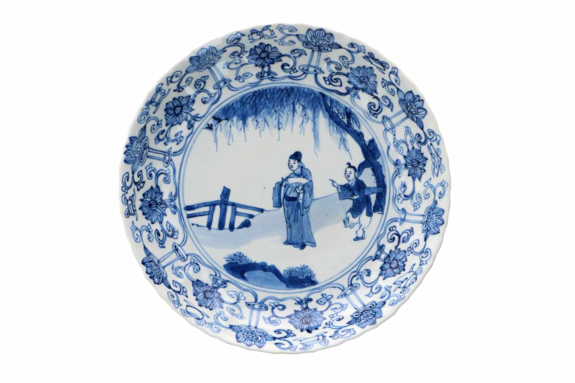 A lobed blue and white porcelain deep dish with scalloped rim, decorated with a dignitary and