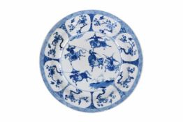 A blue and white porcelain deep charger, decorated with horsemen, flowers and birds. Marked with 6-