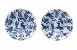 A pair of lobed blue and white porcelain deep dishes with scalloped rim, decorated with long