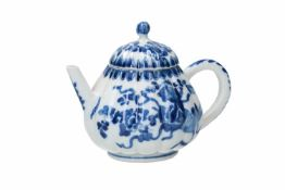 A blue and white porcelain teapot with lobed belly and cover, decorated with flowers. Unmarked.
