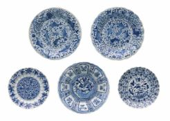 Lot of blue and white porcelain dishes, 1) with scalloped rim, decorated with flowers. Marked with