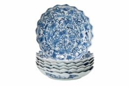 A set of six blue and white porcelain deep saucers with scalloped rim, decorated with flowers and