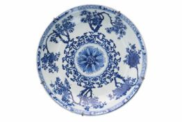 A blue and white porcelain deep charger, decorated with flowers. Marked with artemisia leaf.