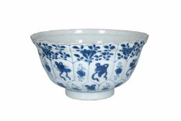 A blue and white porcelain bowl, decorated with flowers and antiquities. The center with three