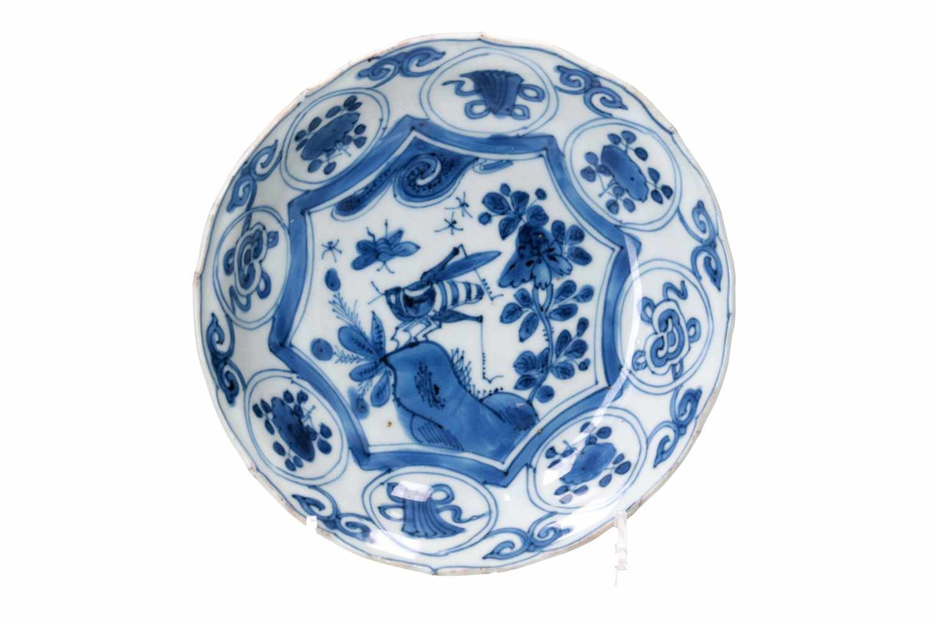 A blue and white 'kraak' porcelain dish, decorated with flowers, a butterfly and a cricket.