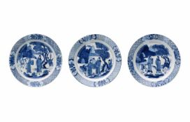 A set of three blue and white porcelain dishes, decorated with figures and a horse. Marked with 6-