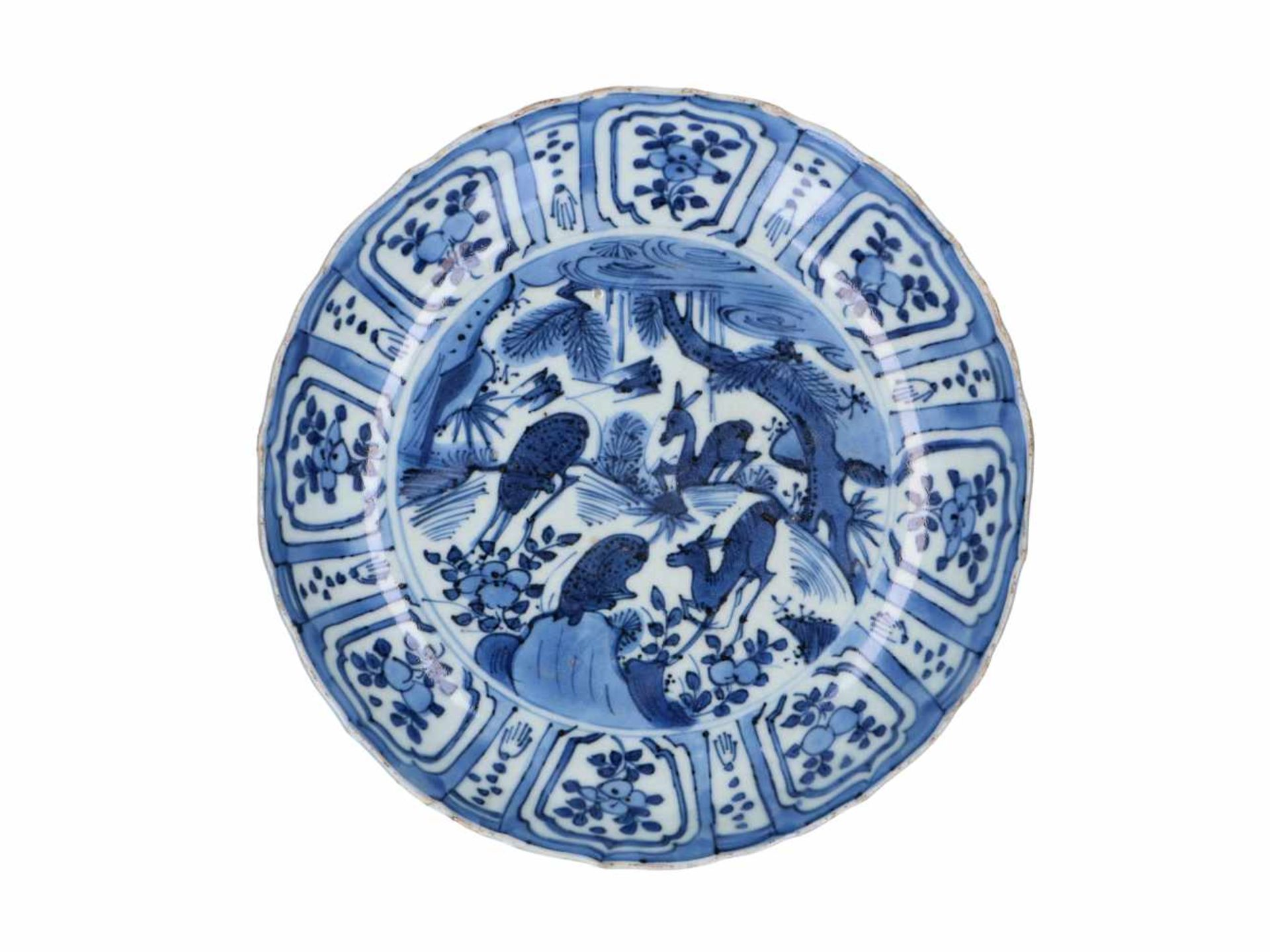 A blue and white 'kraak' porcelain deep dish, decorated with deer, birds and flowers. Unmarked.