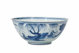 A blue and white porcelain bowl, decorated with a past-master in a mountainous river landscape.