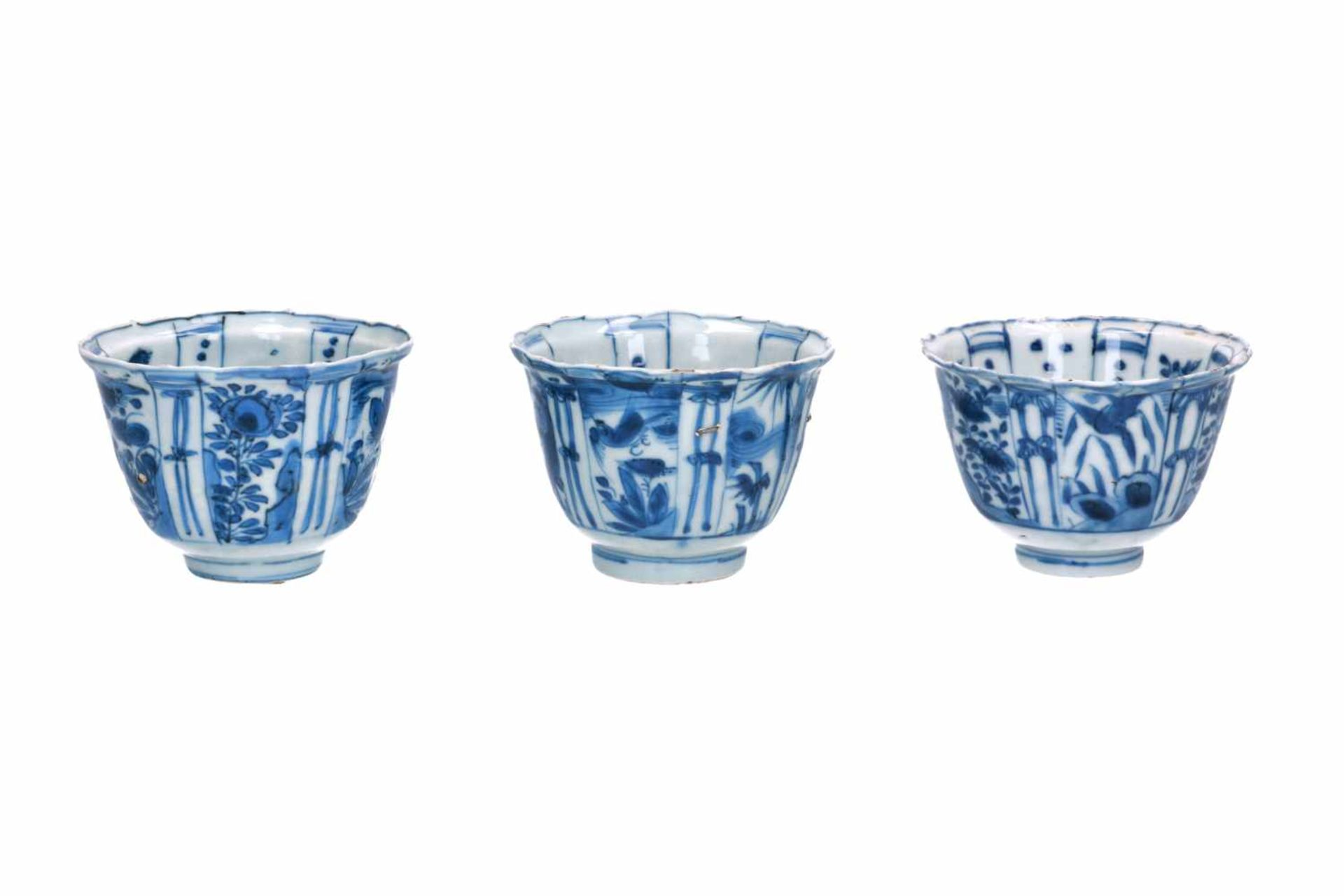 A lot of three blue and white porcelain bowls, decorated with flowers, birds and butterflies.