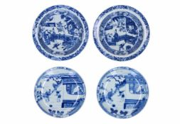 Two pairs of blue and white porcelain dishes, decorated with figures. One pair marked with symbol.