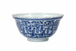 A ribbed blue and white porcelain bowl, decorated with flowers and figures in a garden. Unmarked.