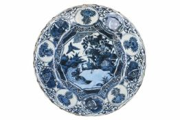 A blue and white 'kraak' porcelain deep charger, decorated with birds, flowers, fruits and