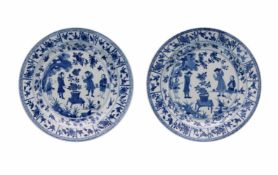 A pair of blue and white Chine de Commande porcelain dishes, decorated with flowers, birds and