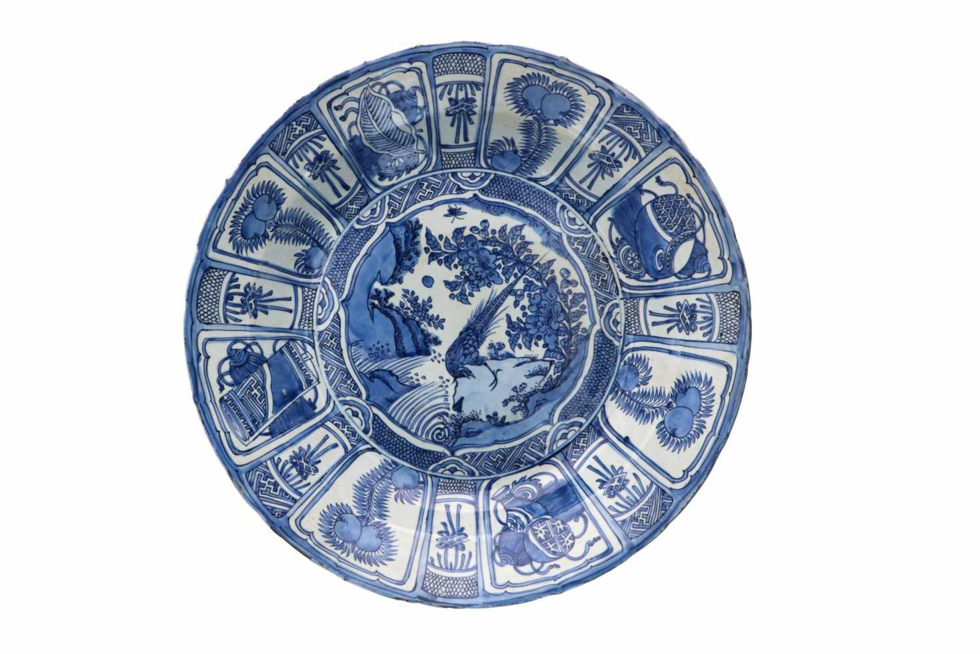 A blue and white 'kraak' porcelain deep charger, decorated with a silver pheasant, fruits,