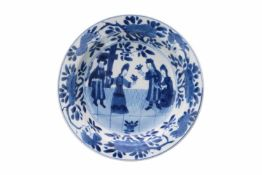 A blue and white Chine de Commande porcelain deep saucer, decorated with figures and flowers. Marked