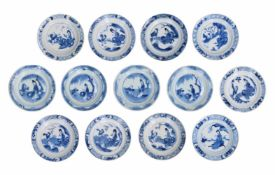A set of 13 blue and white porcelain saucers, decorated with figures. Marked with 4-character