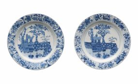 A pair of blue and white porcelain dishes, decorated with flowers and antiquities. Marked with