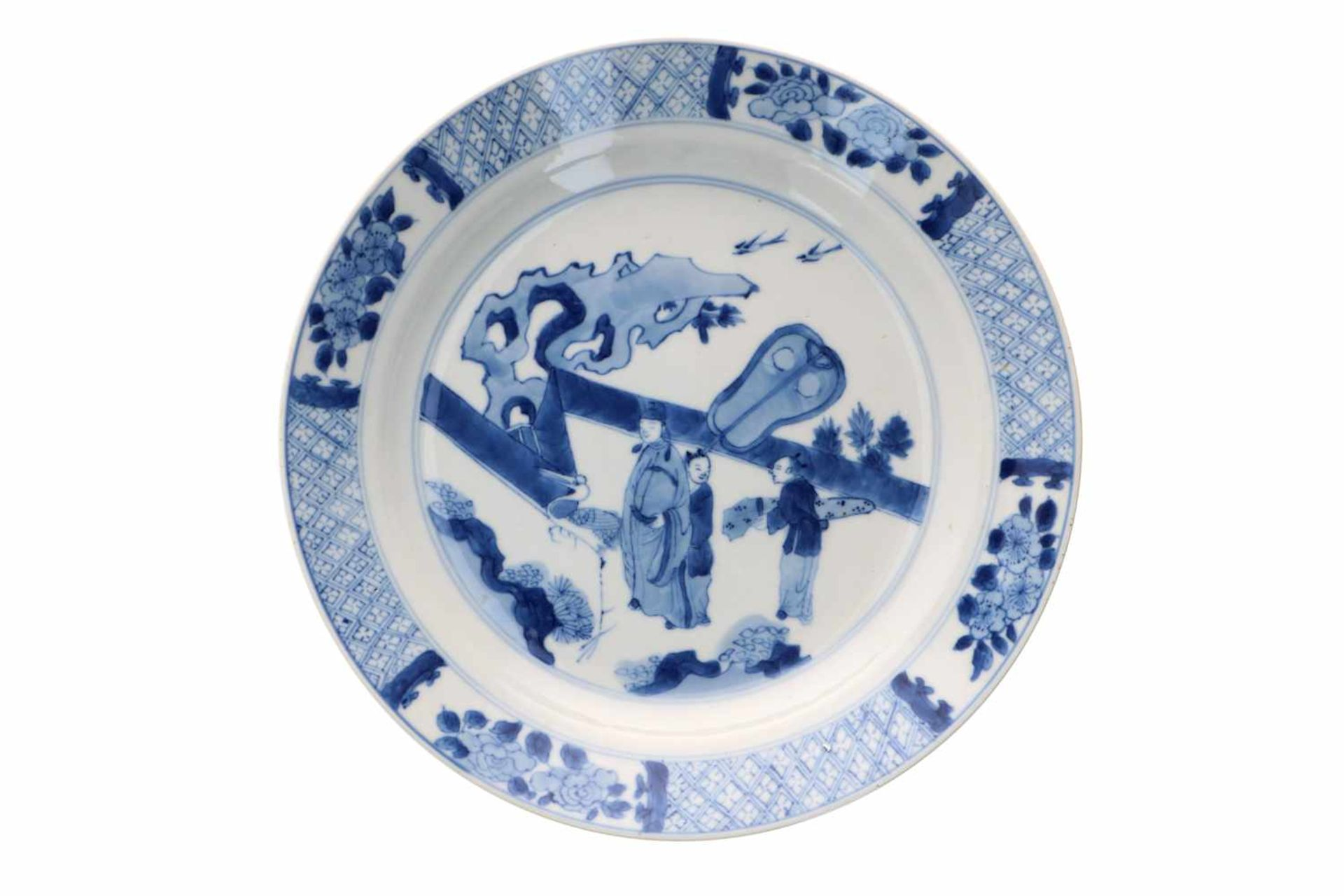 A blue and white porcelain dish, decorated with a dignitary with two servants and a crane on a