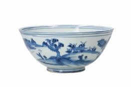 A blue and white porcelain bowl, decorated with figures playing a game of Go in a mountainous