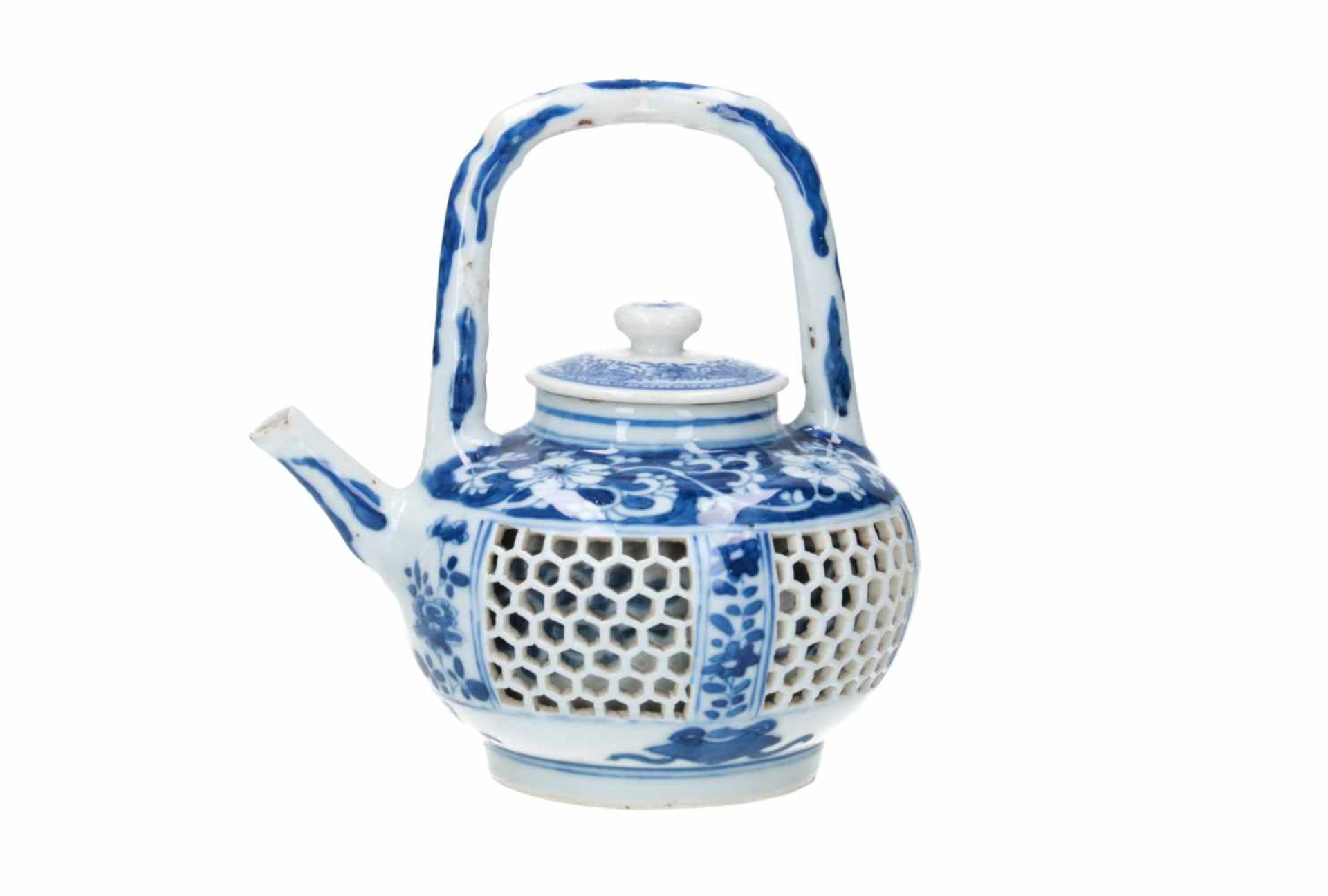 A blue and white porcelain teapot with open work belly, decorated with flowers and censers. Cover