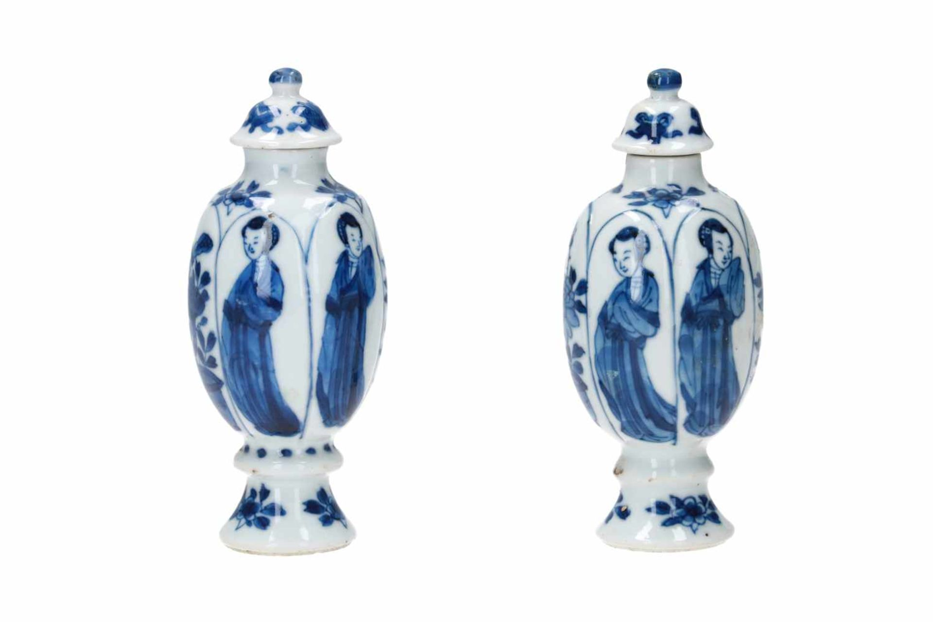 A pair of blue and white porcelain lidded miniature vases, decorated with long Elizas and flowers.