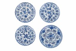 A set of three blue and white porcelain dishes, decorated with flowers. Marked with 6-character mark