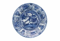 A blue and white porcelain charger, decorated with water birds and reserves depicting peaches and