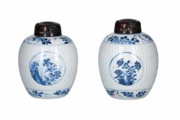 A pair of blue and white porcelain ginger jars with wooden lid, decorated with flowers. Unmarked.