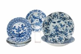 Lot of seven blue and white porcelain dishes with diverse decorations. All marked. China, Kangxi.