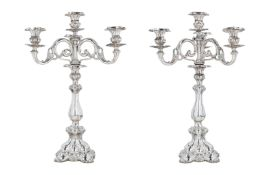 A pair of second grade silver three-armed candelabra, with partly fantasy marks. Holland, 1917. Tota