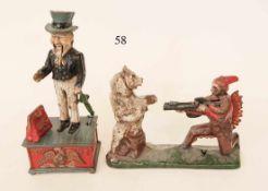 2 mechanische Spardosen, USA um 1910