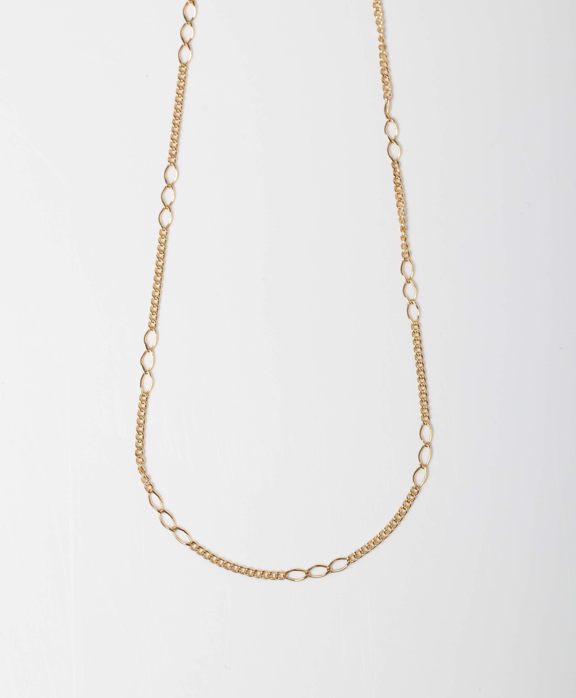 A 9CT GOLD FANCY FIGARO CHAIN