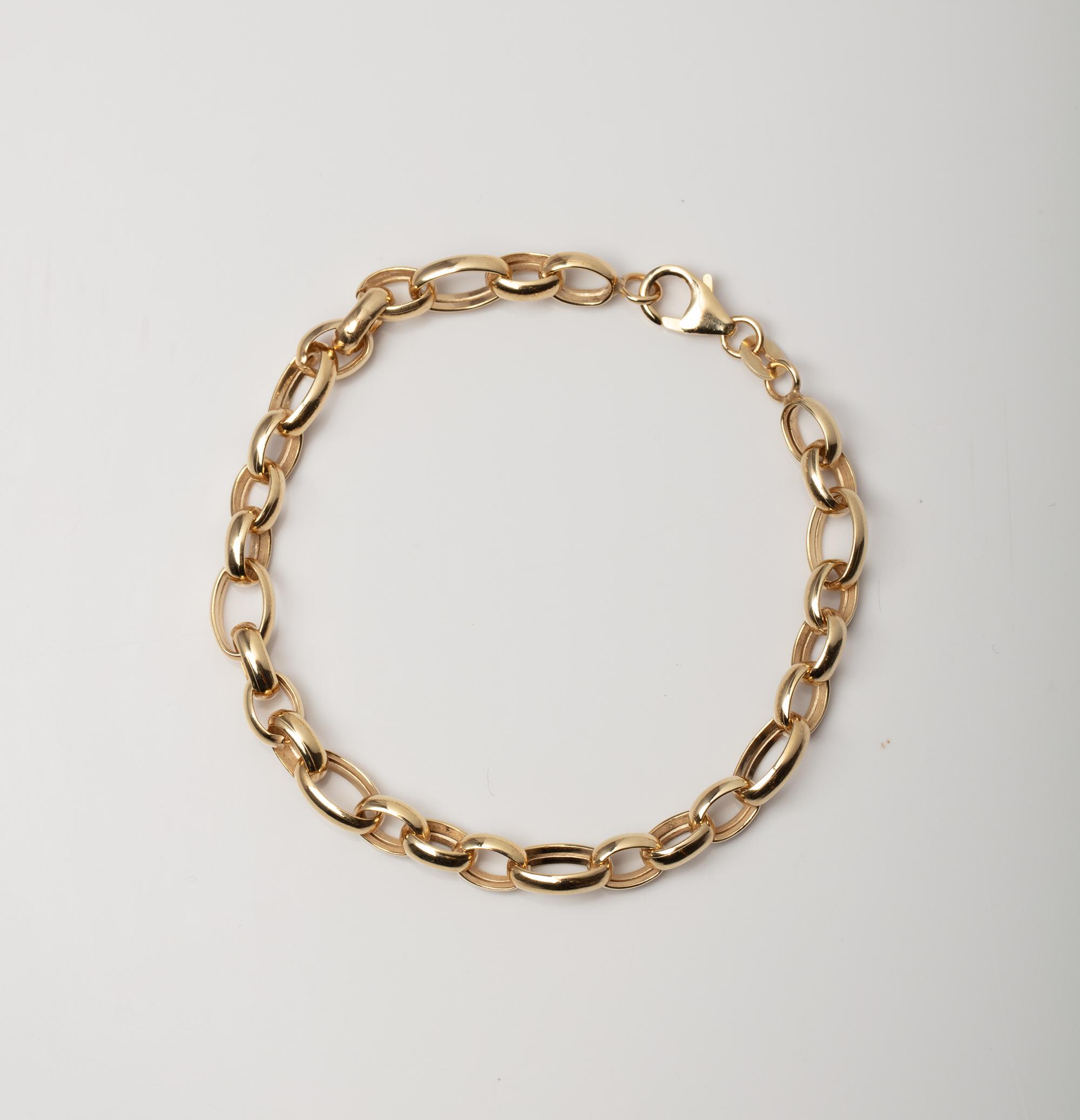 A 9CT GOLD & SILVER BONDED FANCY LINK BRACELET