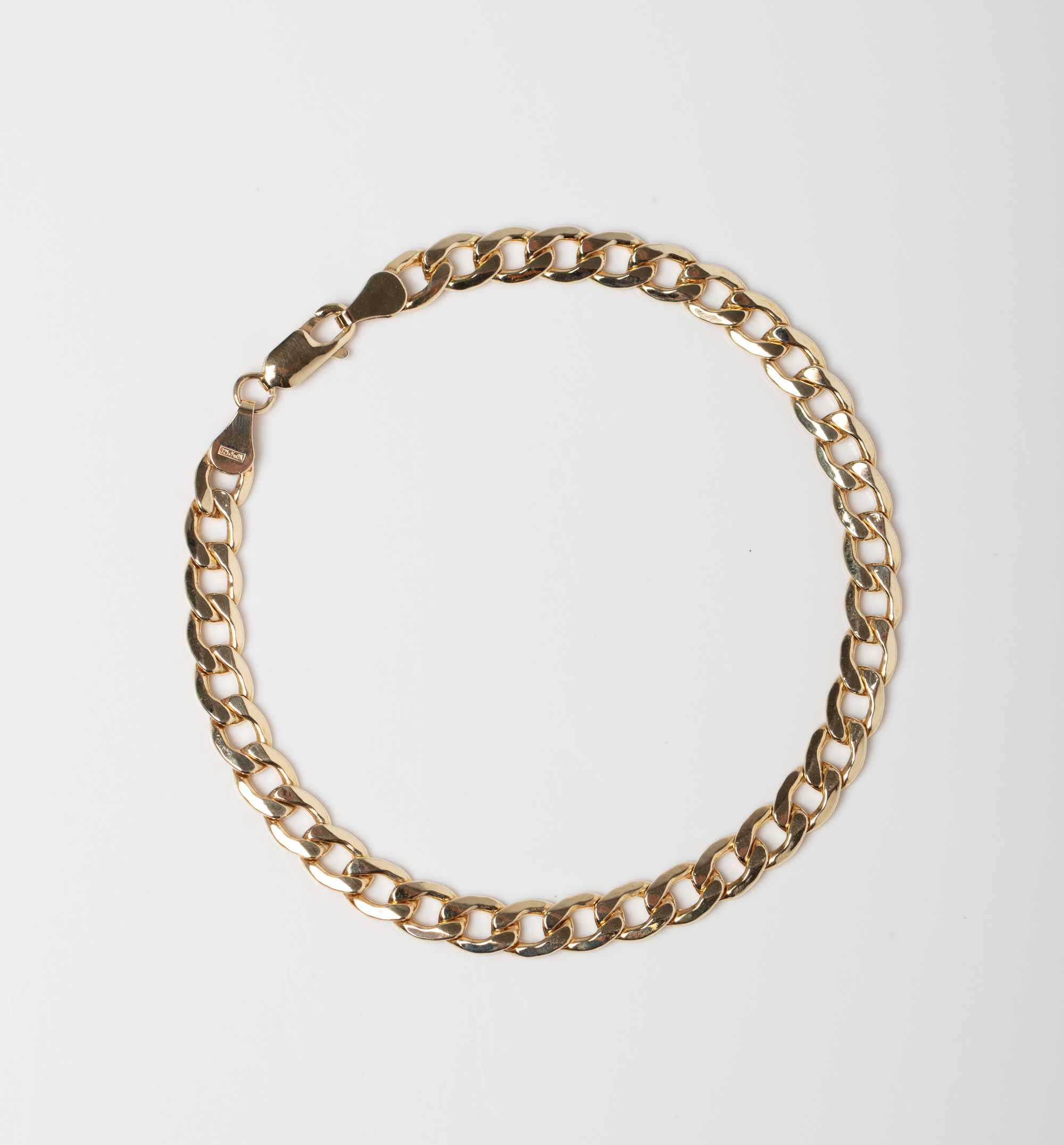A 9CT GOLD & SILVER BONDED CURB BRACELET