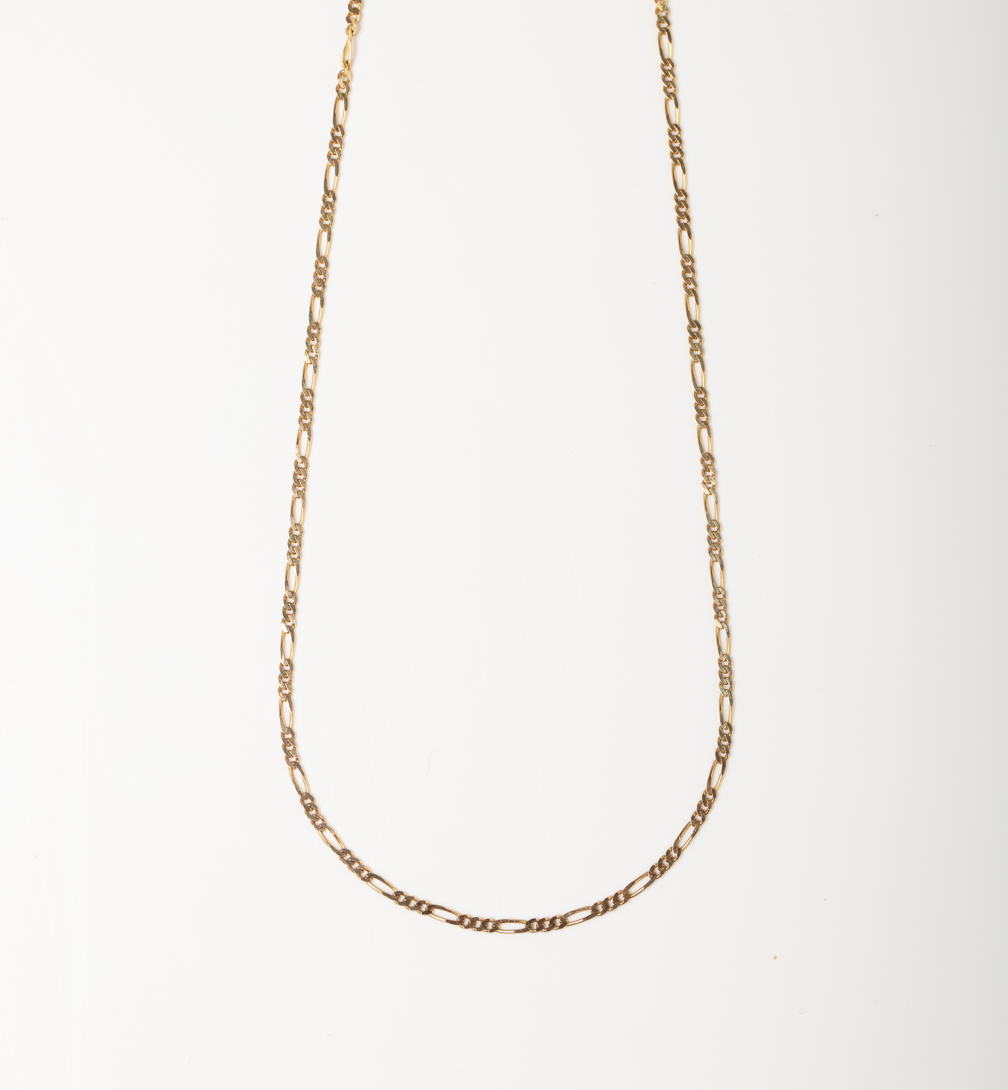 A 9CT GOLD FIGARO CHAIN