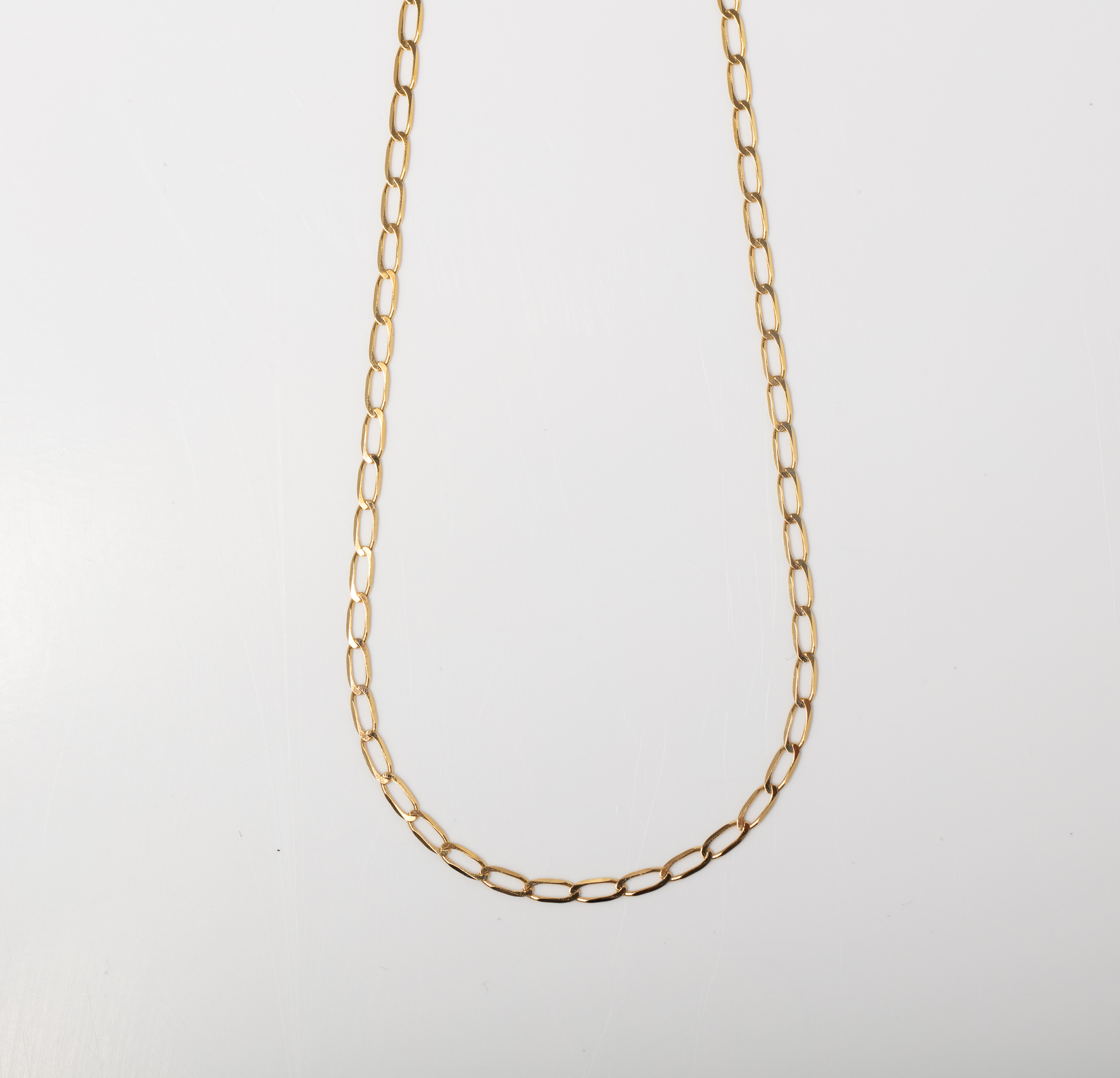 A 9CT GOLD LONG LINK CURB CHAIN